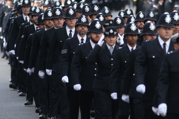 Image: London Police officers march along the funeral route of PC Keith Palmer