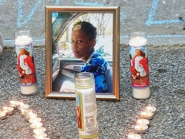 Image: Candles burn around a photo of Malachi Hemphill