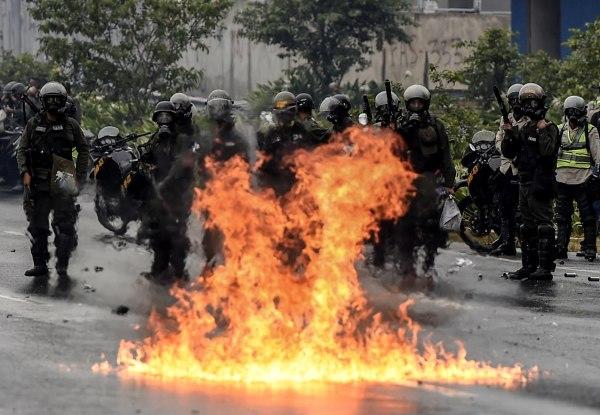 Image: TOPSHOT-VENEZUELA-CRISIS-OPPOSITION-PROTEST
