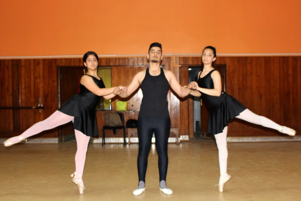 Image: Mass Taiseer, 14 (left) and Asawer Shamel,14 (right) learn ballet alongside male students