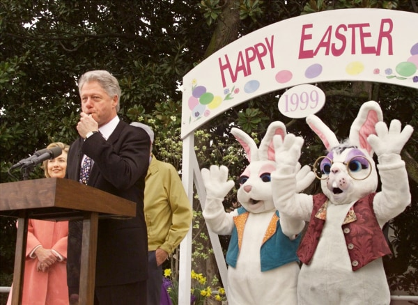 Image: President Bill Clinton blows a whistle to signal the start of the annual Easter egg roll