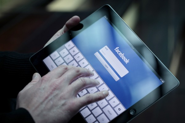 Image: A Facebook user logs into account