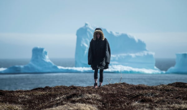 Image: Resident views the first iceberg of the season as it passes the South Shore of Newfoundland