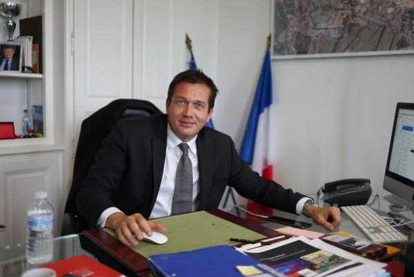 Image: Mayor Marc Etienne Lansade sits at his desk