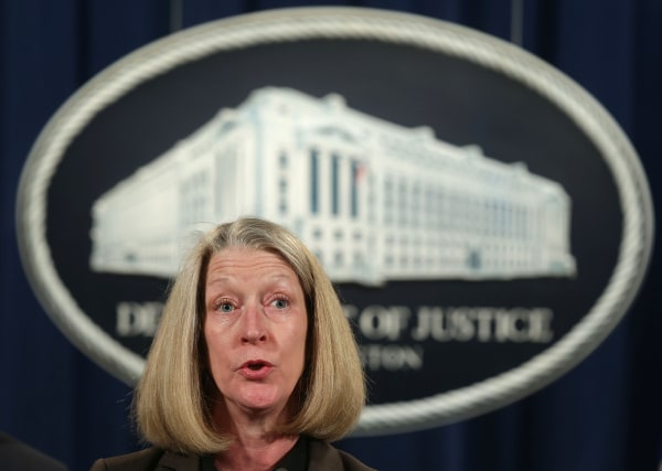Image: Mary McCord speaks during a news conference at the Justice Department