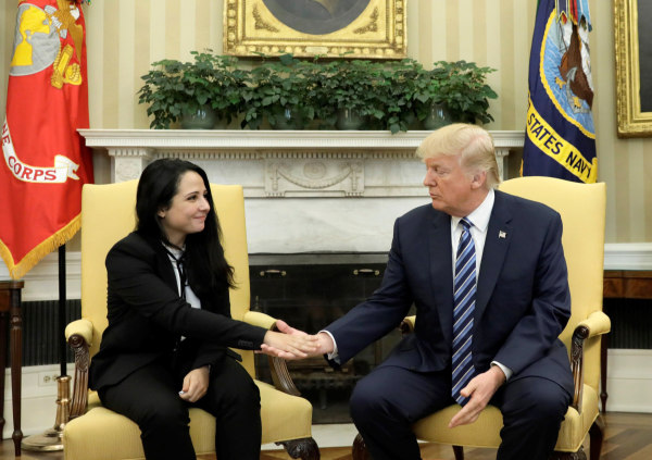 Image: Aya Hijazi, an Egyptian-American woman detained in Egypt for nearly three years on human trafficking charges, shakes hands with U.S. President Donald Trump in the Oval Office of the White House in Washington, April 21, 2017.