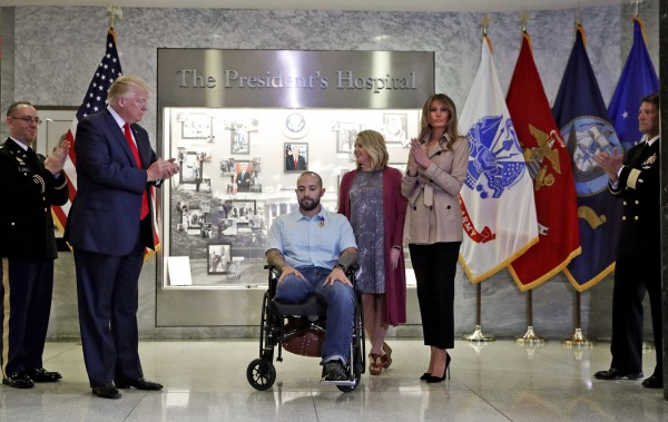 Image: President Donald Trump applauds after awarding a Purple Heart to U.S. Army Sgt. 1st Class Alvaro Barrientos.