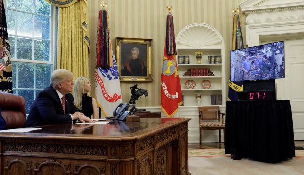 Image: Trump speaks to astronauts from the White House in Washington