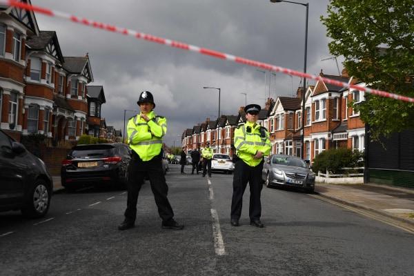 Image: Police cordon off London road after anti-terror raid