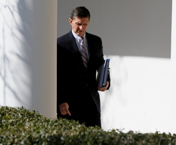 Image: Michael Flynn walks down the White House colonnade
