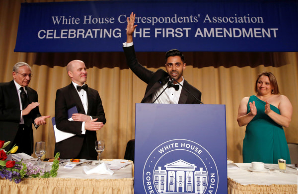 Image: Members of the head table applaud as Minhaj finishes his performance at the White House Correspondents' Association dinner in Washington