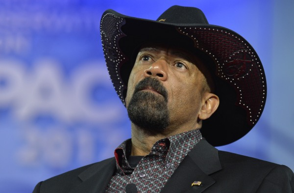 Image; Milwaukee County Sheriff David A. Clarke, Jr. listens to remarks during the Conservative Political Action Conference (CPAC) at National Harbor, Maryland, Feb. 23, 2017.