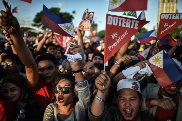 Image: Supporters of presidential candidate and Davao Mayor Rodrigo Duterte cheer during an election campaign rally ahead of the presidential and vice presidential elections in Manila on May 7, 2016.