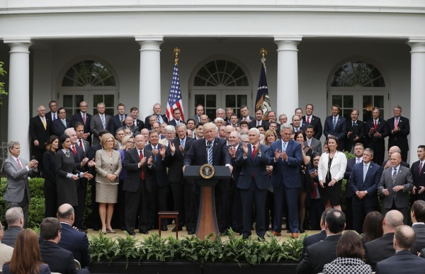 Image: Trump gathers with Republican House members after healthcare bill vote at the White House in Washington
