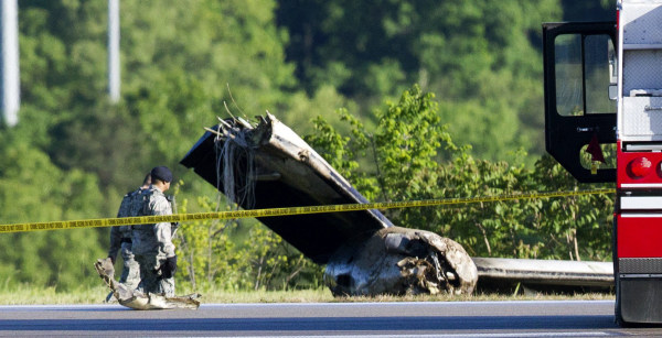 Image: Part of a cargo plane lays on the ground following a fatal crash at Yeager Airport in Charleston, W. Va.