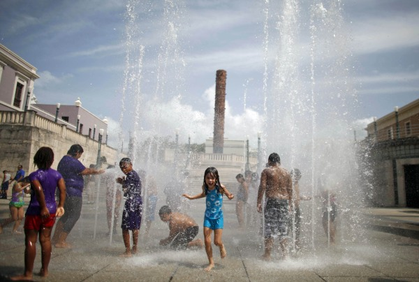 Image: Children cool off at a water fountain during the Summer Solstice in Old San Juan, Puerto Rico on June 21, 2013.