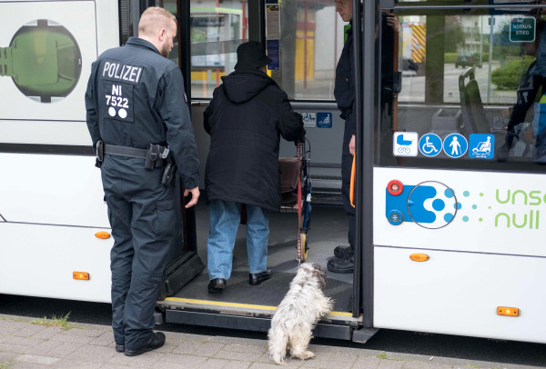 Image: A police officer helps an old woman of the district Vahrenwald in Hanover, central Germany, during the evacuation on May 7, 2017.