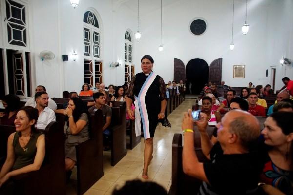 Image: Alexya Salvador (C), a Brazilian trans pastor, walks during a mass in a church in Matanzas
