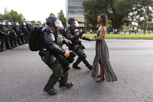 Image: FILE PHOTO --  Lone activist Ieshia Evans stands her ground while offering her hands for arrest as she is charged by riot police during a protest against police brutality outside the Baton Rouge Police Department in Louisiana