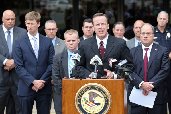 Image: FBI special agent Adam Lee speaks during a press conference