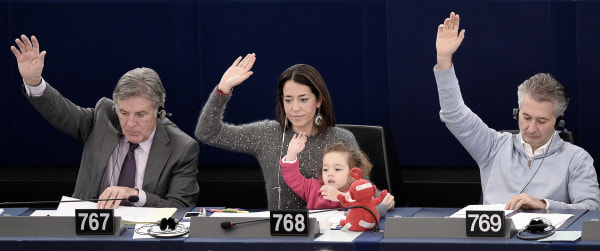 Image: Italy's Member of the European Parliament Licia Ronzulli takes part with her daughter Victoria in a vote