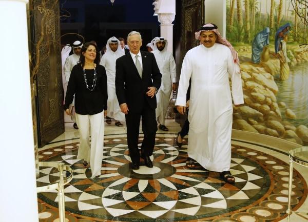 Image: Qatar's Minister of Defense Khalid bin Mohammad Al-Attiyah with Defense Secretary James Mattis and Ambassador to Qatar Dana Shell Smith