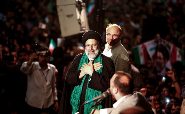 Image: Iranian presidential candidate Ebrahim Raisi (C) greets his supporters as he stands with former presidential candidate and mayor of Tehran