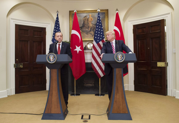 Image: US President Donald Trump and Turkish President Recep Tayyip Erdogan speak to the press in the Roosevelt Room