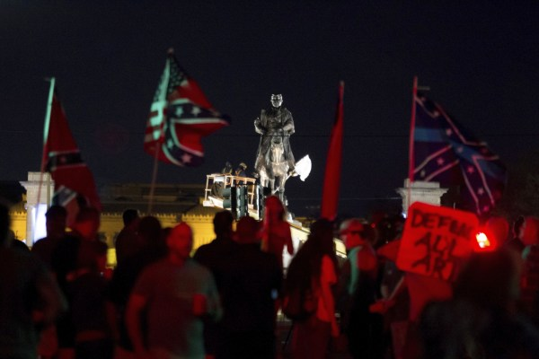 Image: A statue of Confederate Gen. P.G.T. Beauregard is prepared for removal