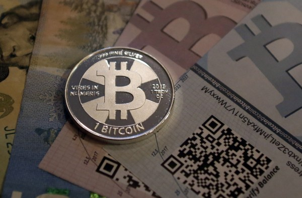Image: One of Bitcoin enthusiast Mike Caldwell's coins in this photo illustration at his office in Sandy
