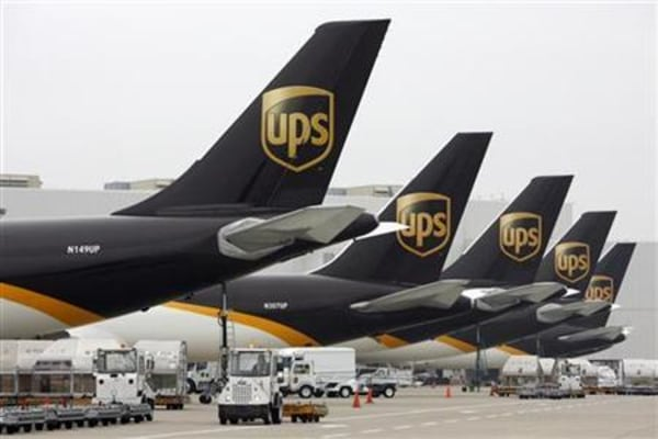 United Parcel Service aircraft are loaded with air containers full of packages bound for their final destination at the UPS Worldport All Points International Hub