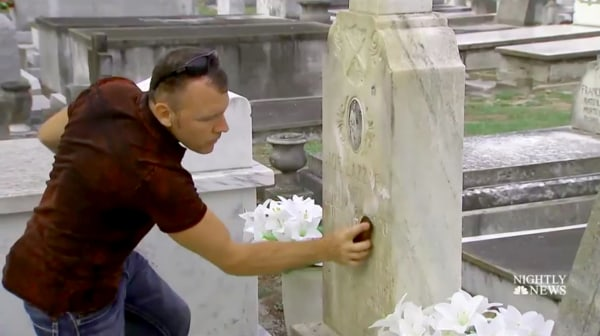 "Image: Andrew Lumish, Tampa's ""good cemeterian"" cleans the headstones of fallen soldiers."