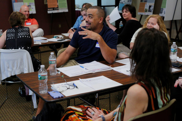 Image: High school math teacher Chris Johnson speaks during a training session with the group History Unerased in Lowell