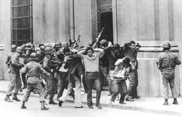 Image: FILE PICTURE SHOWS SOLDIERS CHILEAN AT PRESIDENTIAL PALACE LA MONEDAUNDER FIRE IN 1973.