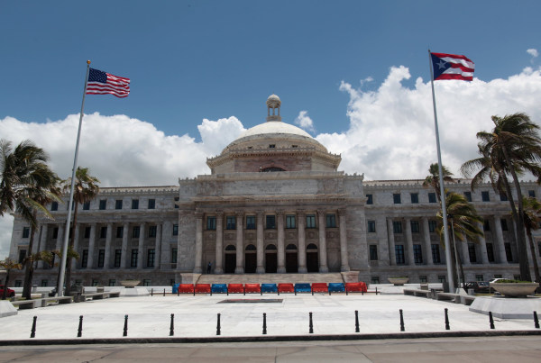 Image: The flags of the U.S. and Puerto Rico fly outside the Capitol building in San Juan