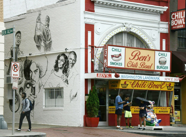 Image: Pedestrians walk past the new mural at Ben's Chili Bowl