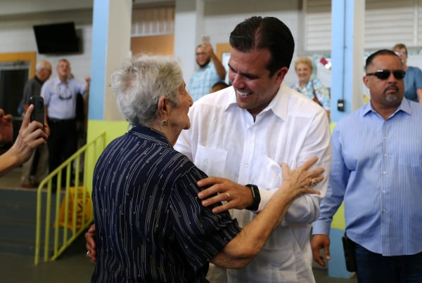 Image: Puerto Rico's Governor Ricardo Rossello greets supporters at a polling station