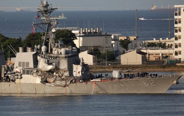 Image: The Arleigh Burke-class guided-missile destroyer USS Fitzgerald, damaged by colliding with a Philippine-flagged merchant vessel, arrives at the U.S. naval base in Yokosuka