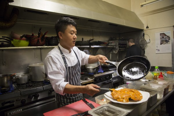 Image: King, a 34-year-old Korean barbecue owner in New Malden