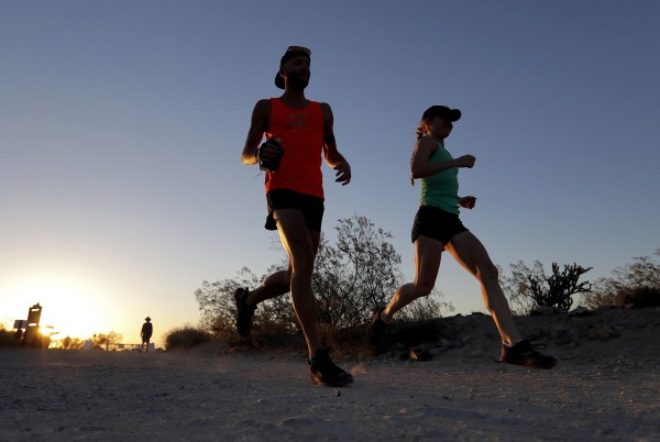 Image: A couple runs through section of South Mountain Park in Phoenix
