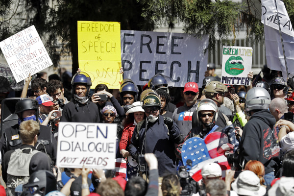 Image: A crowd gathers around speakers during a rally for free speech