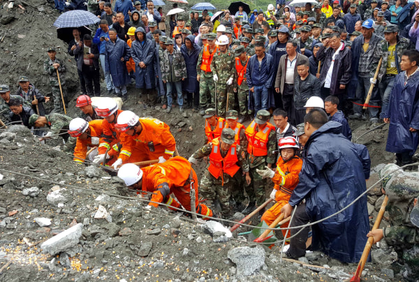 Image: Massive landslide buries over 120 in Sichuan Province, southwest China
