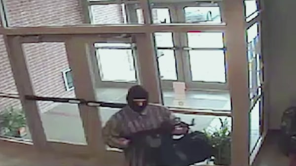 Image: A suspect known as the AK-47 Bandit appears in surveillance video