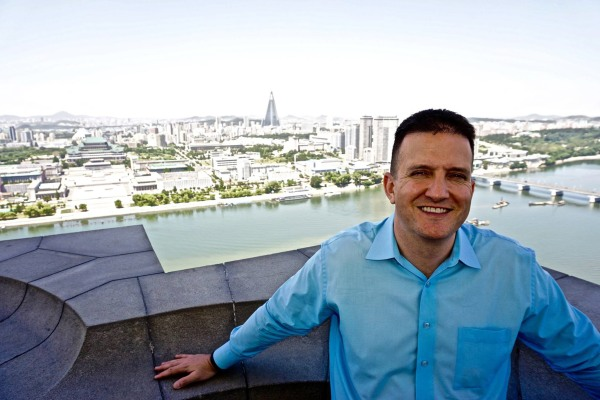 Image: Randy Williams poses at the top of the Juche Tower in Pyongyang