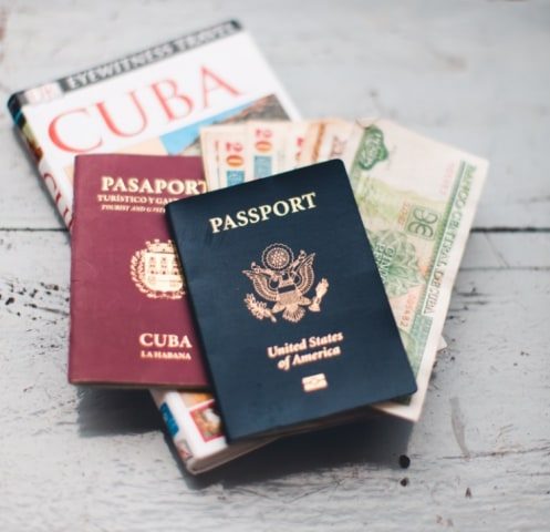 Image: Cuban Money with Cuban and American Passport