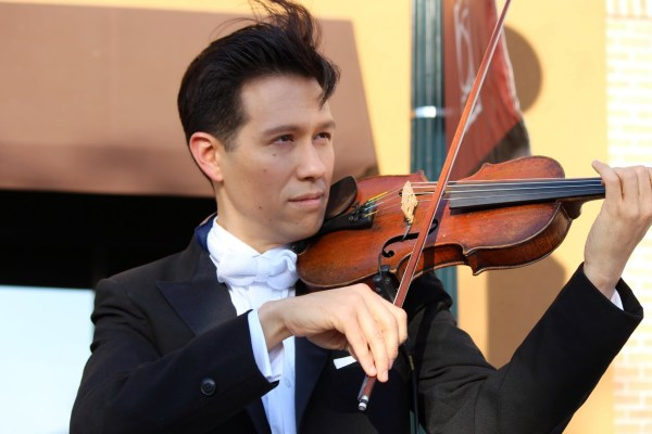 Image: A close-up of Dr. Adam Kendall playing the violin.
