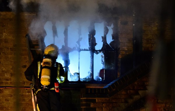 Image: A firefighter tackles a fire at Camden Market in north London