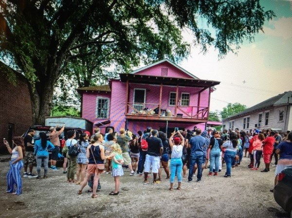 Image: A crowd gathers outside of rapper 2 Chainz pink painted 'Trap House' after Trap Church even hosted in Atlanta, Georgia.