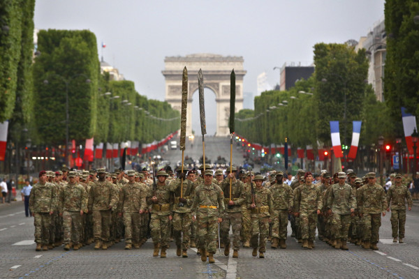 Image: Members of the U.S. Army 1st Division, U.S. Air Force, U.S. Navy and U.S. Marines, march during a rehearsal for Bastille Day