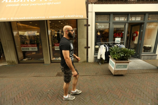 Image: Adel Saflou walks down a quiet street in Deventer, Netherlands